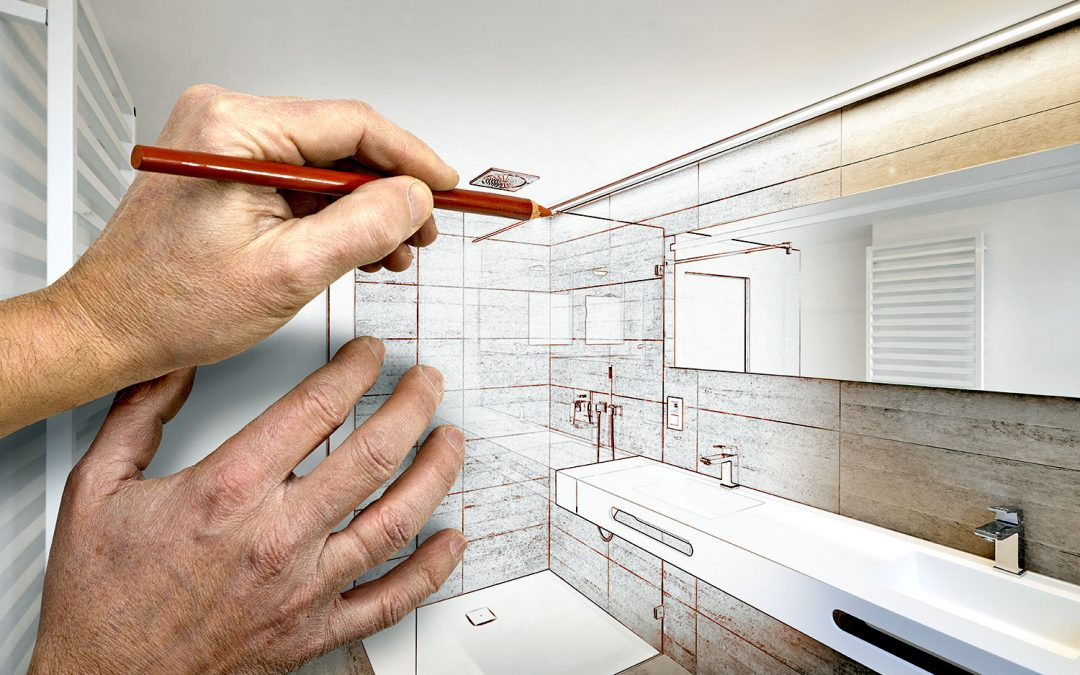 Hands creating a layout of their dream basement bathroom
